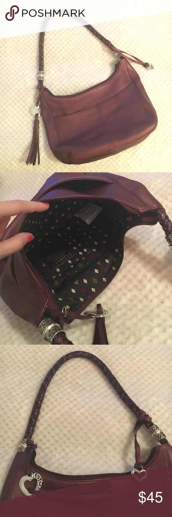 Brighton purse Beautiful Brighton bag. Deep red/wine leather. NWOT. Has four outside pockets, multiple inside pockets. Brighton Bags