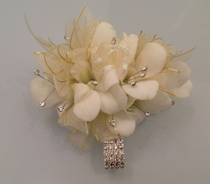 White Dendrobium Orchids with Crystal Bracelet Corsage. Terra Flowers Miami. Perfect for Weddings, Proms or Graduations. Please visit www.TerraFlowersMiami.com for ordering details.