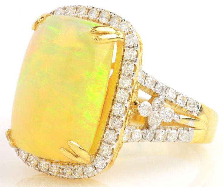 Eye-catching Yellow Opal statement ring with white diamonds in yellow gold #AustraliaOpal