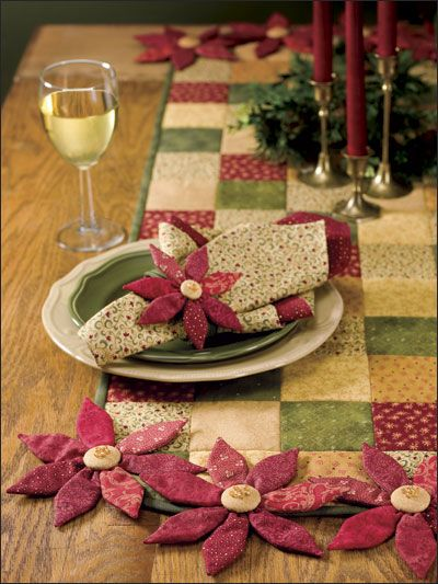 Poinsettia Table Set Quilt Pattern Download from e-PatternsCentral.com -- Use coordinating festive fabric scraps to create a bouquet of 3-D flowers, perfect for adorning a quick-to-stitch holiday table runner and matching napkin rings.