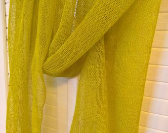 This eco and natural linen scarf is an elegant addition to a spring/ summer wardrobe. Each item is carefully handmade from 100% natural linen. Scarf is stretchable.If you want to shorten scarf just stretch it to the sides. If you want to make it a bit longer just stretch it to the length. Itis made on a knitting machine from pure linen. Care instructions: Gentle hand wash in 30 degrees, do not stretch and spin. Dry on a flat surface. Iron while a bitwet.
