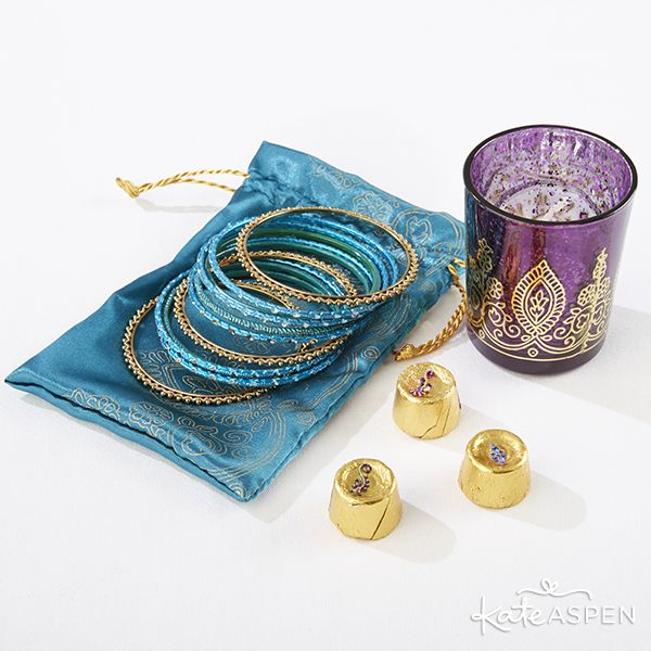 Pretty bangles in a favor bag, colorful henna votives and DIY bindi chocolates all make fantastic gifts for guests for a mehndi or sangeet!