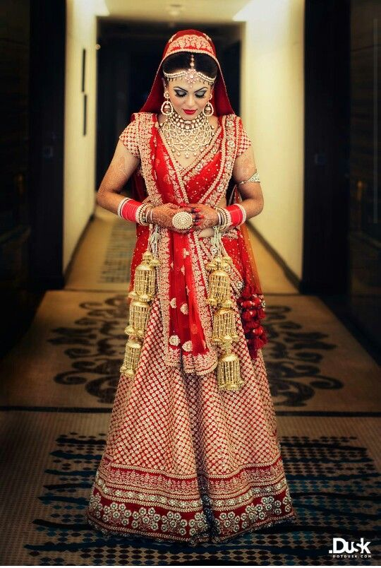 Sabyasachi red and gold bridal outfit. Indian wedding lehenga
