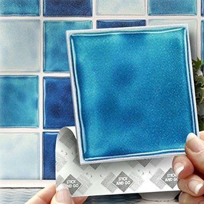 "BLUE MIX EFFECT WALL TILES: Box of 18 tiles Stick and Go Wall Tiles 4""x 4"" (10cm x 10cm) Each box of mixed tiles will cover an area of 2 SQR. FT. NO CEMENTING NO GROUTING NO MESS! TILE OVER ANY SIZE OF TILE OR ONTO THE WALL. Adhesive Wall Tiles that cover the area underneath. Steam & Water Resistant with the look of Ceramic Tiles. An instant makeover for both Kitchens & Bathrooms."