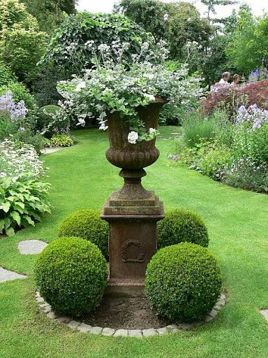 Via HEATHER LEYDA REYNOLDS @hthrnids Pic: Lawned garden with topiary and borders