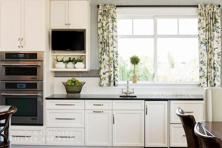 Beautiful transitional kitchen features white shaker for White kitchen cabinets with brushed nickel hardware
