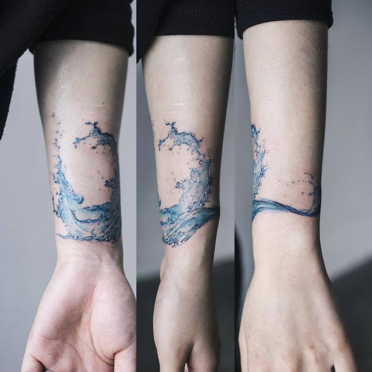 Scar cover tattoo on a water splash on the left inner forearm. Tattoo artist: Sol Tattoo