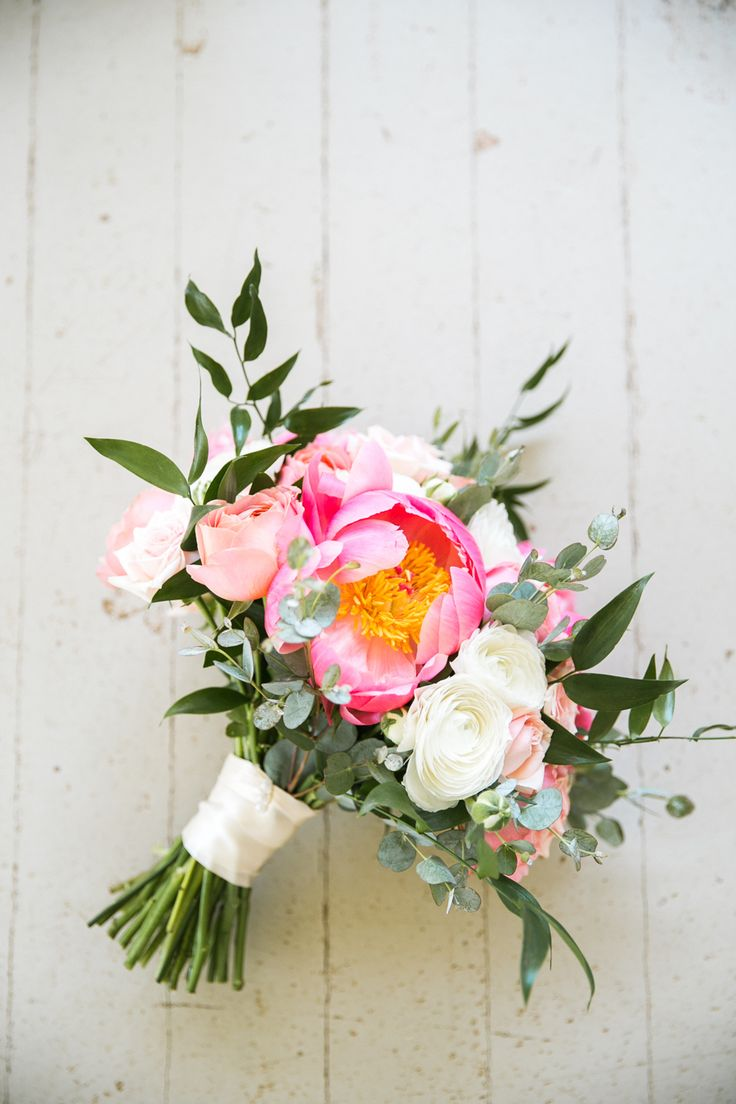 Colorful pink peony, ranunculus and rose wedding bouquet: Photography: Jasmine Lee Photography - jasmineleephotography.com   Read More on SMP: http://www.stylemepretty.com/destination-weddings/hawaii-weddings/2017/03/08/colorful-destination-maui-wedding/
