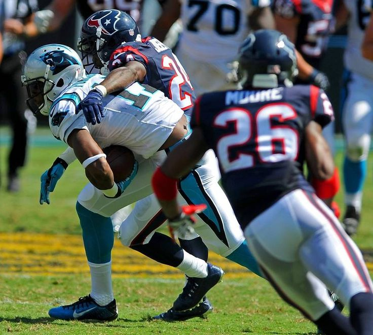 Carolina Panthers wide receiver Devin Funchess, left, turns to try and pick up yardage following a pass reception as Houston Texans cornerback Johnathan Joseph, center, looks to make the tackle during second quarter action at Bank of America Stadium in Charlotte, NC on Sunday, September 20, 2015. The Panthers defeated the Texans 24-17.