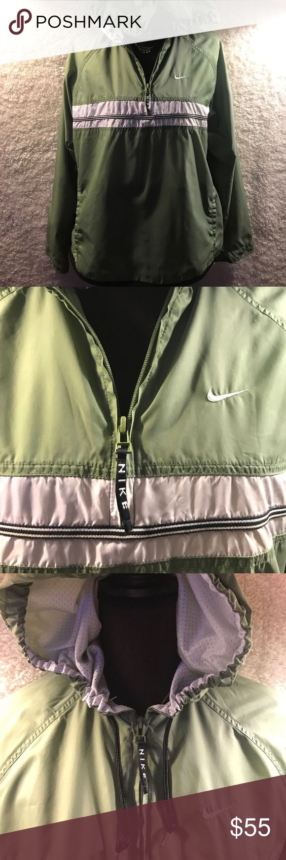Nike rain jacket/wind breaker Green and white Nike rain jacket! Very light and easy to take on and off. Has drawstrings and Velcro to make more fitting Nike Jackets & Coats