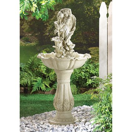 "Make this splendid fountain the centerpiece in your garden! Water flows from an urn held by a fairy maid, cascading down through open blossoms into a scallop-edged bowl. Enchanting and elegant, this creation is fashioned in alabastrite and comes with an electric water pump. UL Recognized. 19 1/2"" diameter x 42"" high."