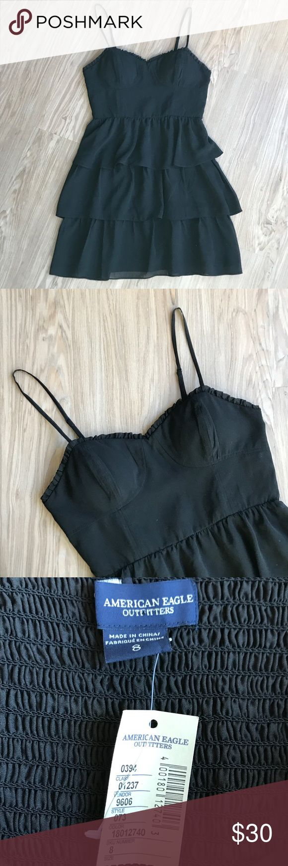 """American Eagle Alluring Little Black Dress NEW SZ8 American Eagle  Little Black Dress Tiered Ruffled Skirt Elastic back Panel Adjustable Spaghetti Straps  Lightly Padded Shelf Bra Fitted Bodice + Side Boning Lined 100% Polyester  Brand new with tags  Size 8 Flat Lay Measurement: 15"""" Bustline   13"""" high waist   32"""" length + 3"""" strap drop.  Please keep in mind that there is a back Panel of full stretch. True to size.  Great for holiday parties or cocktail hour.  Super cute with with fantastic…"""