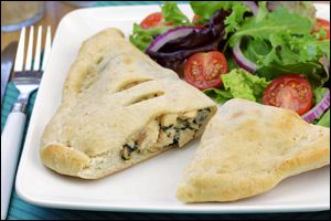 Hungry Girl recipe swap for guilt-free Chicken Alfredo Calzone. Pin and try it!