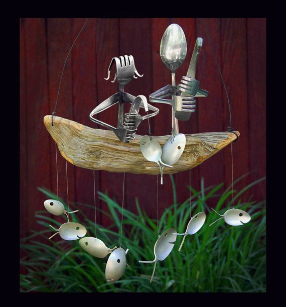 This Darling Duo proudly show off their catch while sitting atop a natural driftwood boat. Perfect for any porch or yard. Driftwood dingy gently will rock in the breeze producing a delightful mellow sound. Many variations available - customize for the perfect gift! Spoon Fish and Fishing Poles are up-cycled from vintage and antique Silver Plated Flatware. The handcrafted fishermen of are carefully welded from durable stainless steel. All driftwood comes from the depths and NC shores, lake...