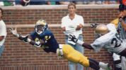 It had been 51 years since Tom Harmon won Michigan's first Heisman Trophy in 1940. The play that put Desmond Howard in the running for a Heisman occurred in the September 14, 1991 Michigan win over Notre Dame in Ann Arbor. Quarterback Elvis Grbac led Howard too far on the pivotal, fourth-and-one pass play. But Howard stretched out like a Slinky in the end zone to make the 25-yard touchdown catch in a 24-14 win over the third-ranked Fighting Irish. Howard was a land-slide winner of the…