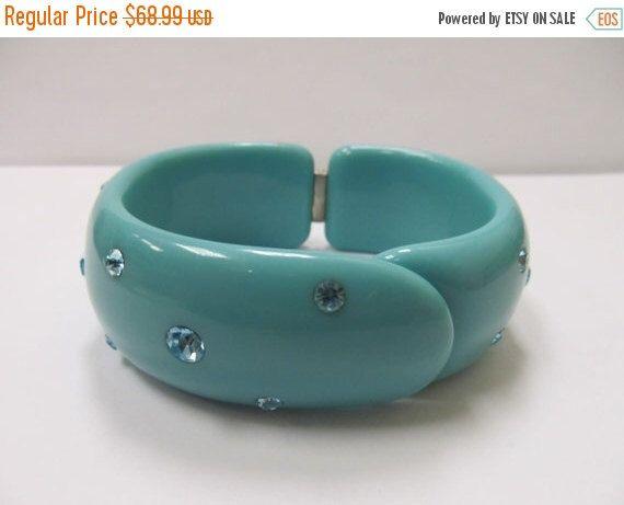 On Sale Vintage Aqua Rhinestone Plastic Hinged Bangle Bracelet Item K # 2433 by KittyCatShop on Etsy https://www.etsy.com/listing/271624021/on-sale-vintage-aqua-rhinestone-plastic
