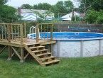 fiberglass above ground pools with rustic wooden decks