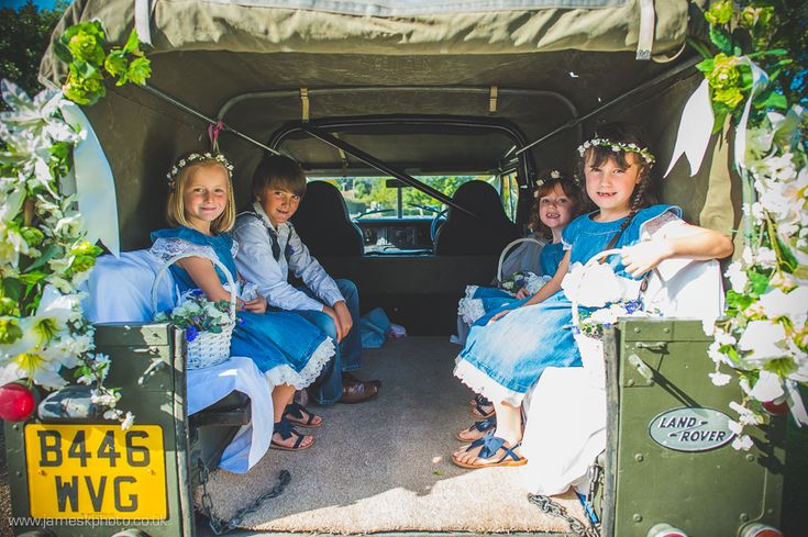 Blakeney Church, Norfolk wedding. Land Rover Defender wedding car. Denim bridesmaids. Denim page boy. Denim flower girl. www.jameskphoto.co.uk