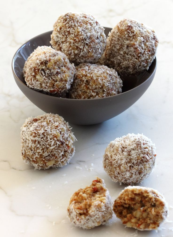 Healthy nut balls - no cooking - raw food. These are delicious. I substituted the dried apricots for cranberries.