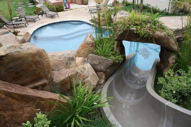 8 best images about water slides on pinterest backyard for Swimming pools with slides and waterfalls