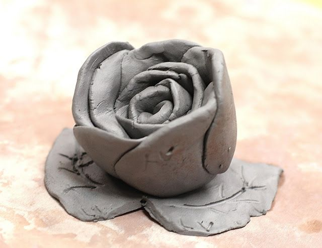 Clay roses made by rolling circles of clay in a spiral ...