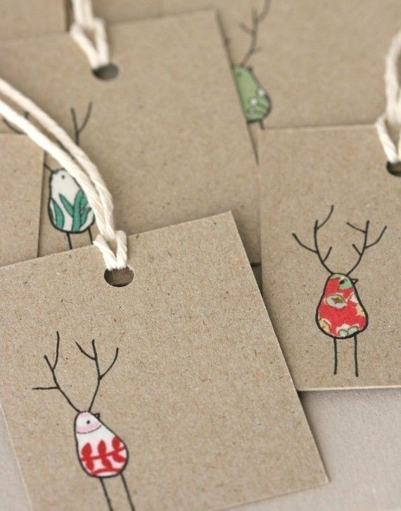 hang tags-- made with cut remnant fabric and hand drawn ink details on kraft paper