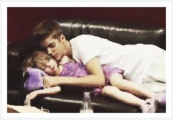 Imagine: Justin brought you on tour with him, since you are dating. After a long show Justin is extremely tired and he sees that Jazzy is sleeping. He squeezed into the couch with her and Kisses her cheek. You wished you had a Brother like Justin growing up.