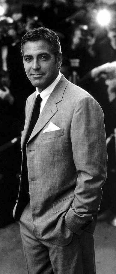 George Clooney - is a modern day Cary Grant with the same combination of sexy good looks and adorable dry humor