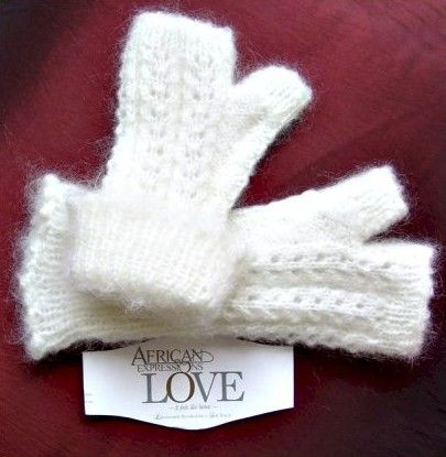 Powder Puff Mohair Mitts. Fingerless and Fluffy, cabled and laced. http:www.knittingstation.com