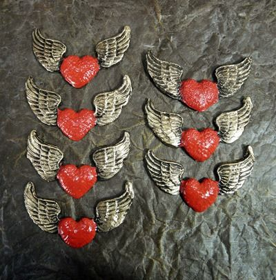 Hearts with wings, made from Friendly Plastic pellets and coloured with acrylic paints and gilding wax.