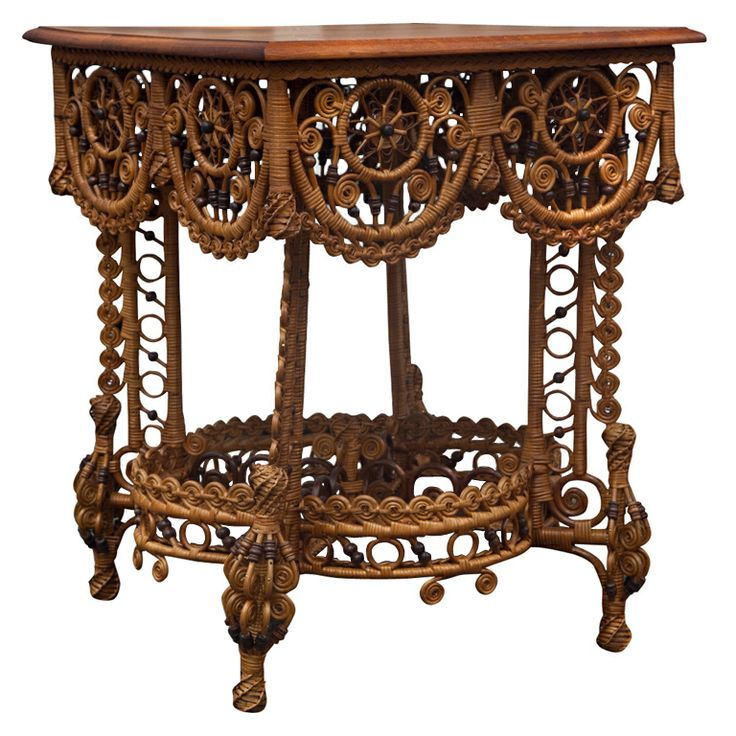 HIghly detailed Victorian Wicker Table  COUNTRY: 	United States  CREATION DATE: 	1890's  MATERIALS: 	Reed and rattan products woven to a hard wood frame.