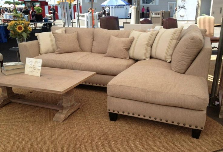 Sectional sofa with built in ottoman on one end.