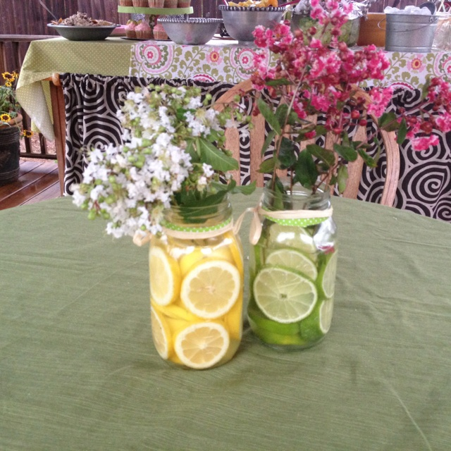 Bridal Shower decorations Place lemons and limes in mason jars along with flowers. So pretty.