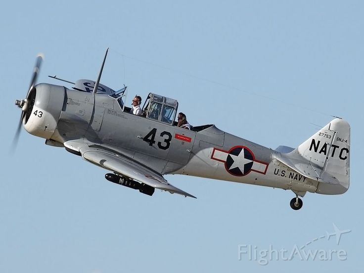 """Dauntless impostor. Actually a North American AT-6 masquerading as a Douglas SBD Dauntless. The cowl and tail are the giveaways. Nice paint job though."""