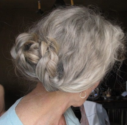 three twisted braids in elegant gray updo hairstyle