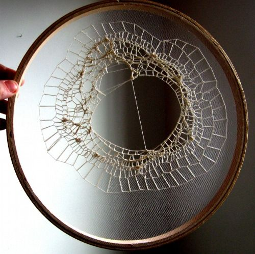 cotton thread on a single layer of tulle in an embroidery hoop