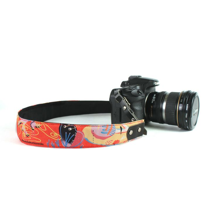 Punchdrunk Panda Camera Strap - {Wilder} - Live a little dangerously with an eye-catching camera strap that's every bit as wild as you. Fran Alvarez unleashes a whirlwind of lines and shapes, capturing what it must feel like to be biggest and baddest animal this side of the jungle. Available in 2 sizes. Price starts from Php495. #punchdrunkpanda #photography #camerastrap