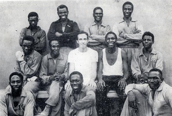 Uganda Boxing team at the Olympics of 1968 in Mexico City. Leo Rwabwogo seated right won bronze and Eridadi Mukwanga (T-shirt) won silver. coach Grace Sseruwagi is standing second from right.