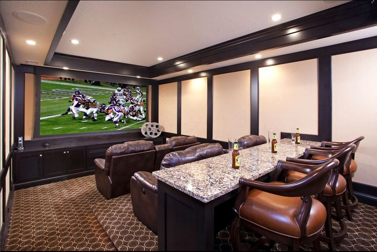 Basement theater room love the stepped seating and bar