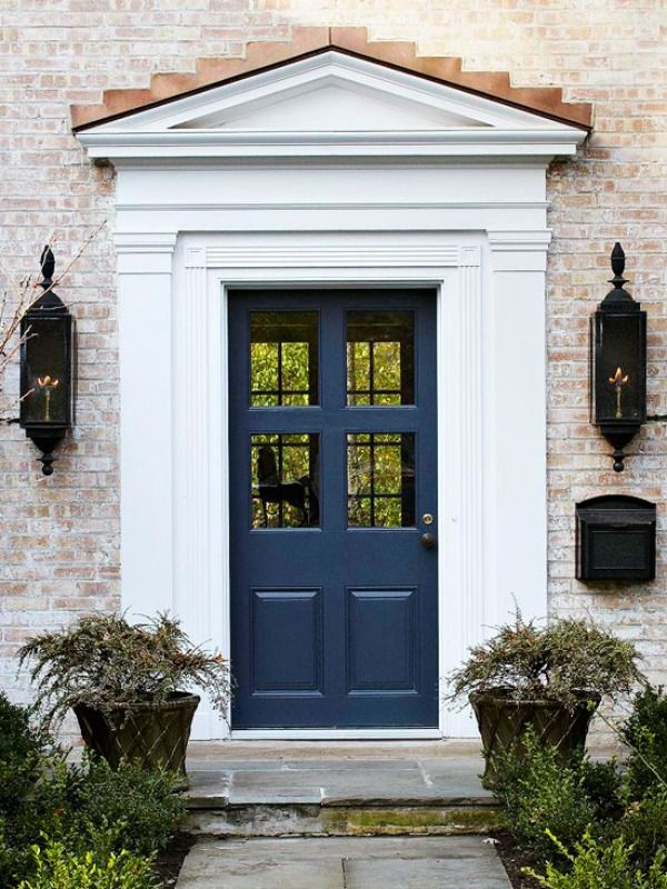 Impressing Colorful Front Doors with Amazing Paint Color: Terrific Navy Blue Door Looking Great With Potted Plants Artistic Wall Lamps Simplw Black Mailbox Brick Walls And Stone Floor