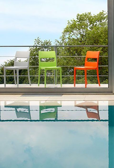 CONTRACT ESSENTIALS | The Sai stackable chair is suited for use indoors or outdoors. #Designicons #Italianfurniture #Interiordesign