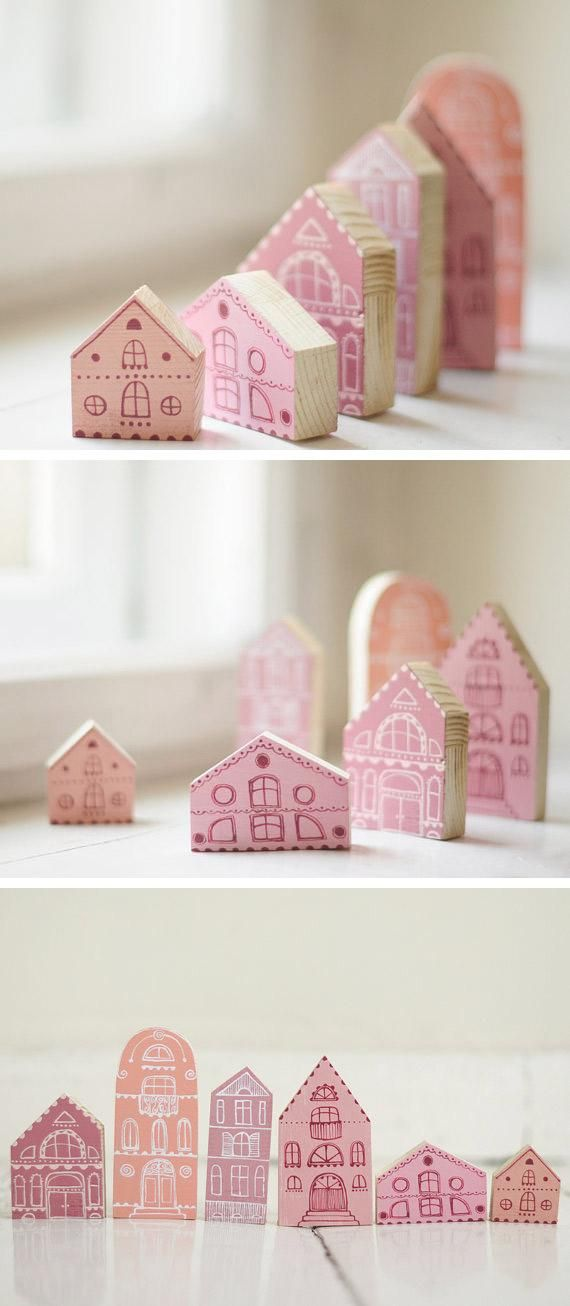 Cute idea // Etsy seller Anamarko's six-piece hand-painted wooden village blurs the line between playtime prop and proper decor. #etsyfinds