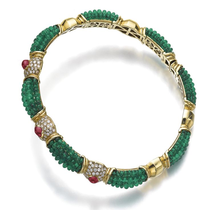 Emerald, ruby and diamond choker The flexible collar set with rows of emerald beads, alternating with gold links, the front set with three cabochon rubies and pavé-set with brilliant-cut diamonds, Italian assay mark.