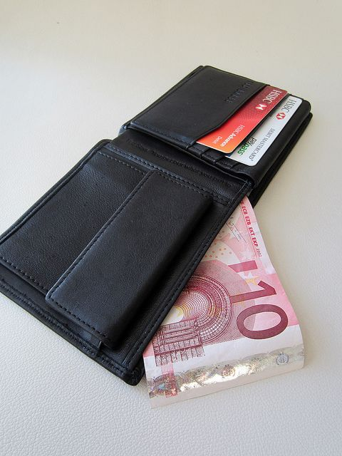 A wallet with credit cards and Euros     Tips onLearn how  Credit Card Debt  Ohio Credit Card Debt Relief  Go to http://paycreditcarddebtoff.org