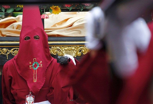 Image: A member of the Nazarenos brotherhood take part in a Holy Week procession in Zipaquira, Colombia. (© John Vizcaino/Reuters)