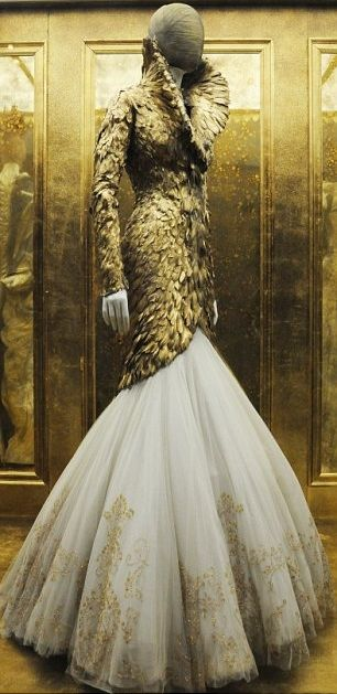A Beautiful Gold Feather Dress by Alexander McQueen... A dress so nice I pinned it twice