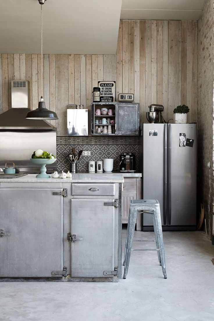 great vintage kitchen interior. also love these slightly maroccan looking tiles in combination with the wooden wall. i would not mind to drink a freshly brewed mint tea on the tolix stool right now.