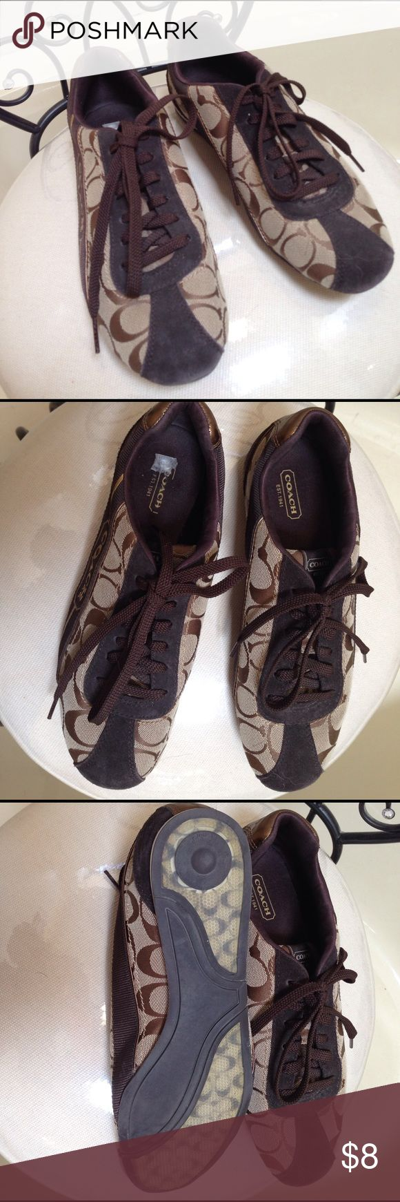 Coach tennis shoes Brown tennis shoes with Coach logo. Worn a few times but in very good condition Coach Shoes Sneakers