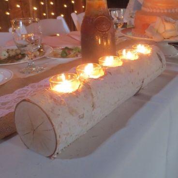 superbe centre de table en réel petit tronc ou vous pouvez déposer des bougies à l'intérieur.