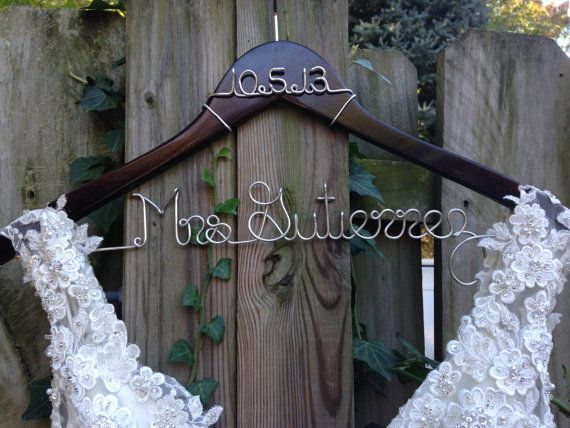 A bride hanger makes a beautiful wedding keepsake. These personalized wooden dress hangers are perfect to hang your wedding dress on, and they make fantastic photo props for your wedding day! You spent forever finding THE DRESS, now it deserves a special hanger! When your photographer shoots photos of your gown, you don't want it hanging on an ugly plastic hanger. Makes a unique bridal shower or engagement gift – a personalized memento that every bride will love. Perfect gifts for your ...
